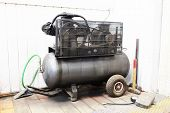 image of air compressor  - The image of air compressor under the white background - JPG