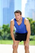 foto of breathing exercise  - Tired man runner exhausted after sport exercise - JPG