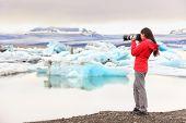 stock photo of arctic landscape  - Nature landscape photographer taking picture photos with SLR camera on Iceland Jokulsarlon glacial lagoon  - JPG