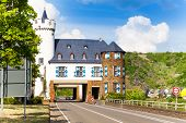 stock photo of public housing  - House above public road near Kurioses Schloss Leyen - JPG