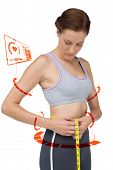 image of girth  - Portrait of a fit woman measuring waist against fitness interface - JPG