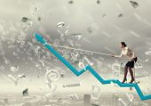pic of pull up  - Businesswoman pulling arrow with rope and making it raise up - JPG