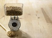 foto of soy bean  - weighing the amount of soy beans - JPG