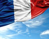 picture of french curves  - French waving flag on a beautiful day - JPG