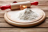 image of plunger  - Heap of flour on cutting board with egg and plunger on wooden table - JPG