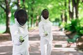 image of rapier  - Two rapier fencers women staying in park alley getting ready for competition - JPG