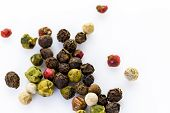 stock photo of peppercorns  - Bold and varied peppercorns on a white background - JPG