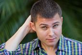 foto of scratching head  - Stock image of a man scratching his head - JPG