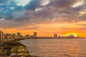 picture of malecon  - Beautiful colorful sunset in Havana with a view of the ocean and the city skyline - JPG