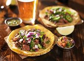 picture of tacos  - authentic mexican tacos with beer on wooden table shot with selective focus - JPG