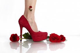 stock photo of stiletto  - Red roses and a red stiletto compliment a young woman - JPG