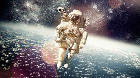 picture of outer  - Astronaut in outer space against the backdrop of the planet earth - JPG