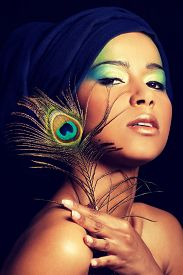 pic of female peacock  - Beauty woman with artistic make up and peacock feather - JPG