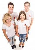 foto of hiv  - Group of young positive people with red ribbon supporting AIDS HIV prevention - JPG
