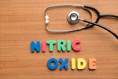 image of oxidation  - Nitric oxide colorful word with stethoscope on the wooden background - JPG