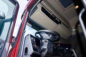 foto of truck-cabin  - Lorry driver cabin and CB radio steering wheel - JPG