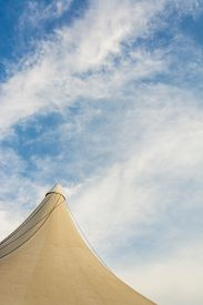 image of circus tent  - image of circus tent and clear blue sky in background - JPG