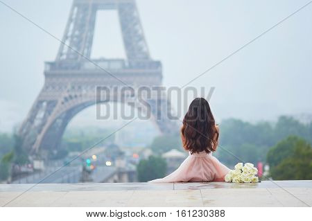 Parisian Woman In Front Of The Eiffel Tower poster