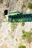 stock photo of motor coach  - engine coach on railway viaduct near Tua - JPG