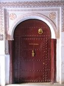 Oriental Architecture With Painted Stuc And Azulejos On A Door, Moroccan Medersa, Marrackech, Morocc poster