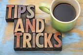 tips and tricks word abstract in letterpress wood type with a cup of coffee poster