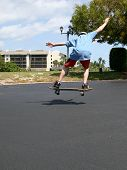 Boy Jumping While On Skateboard