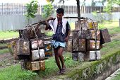 BOMBAY, INDIA - 30 JUNE 2008: The man is working as a porter. One of the most popular ways to earn m