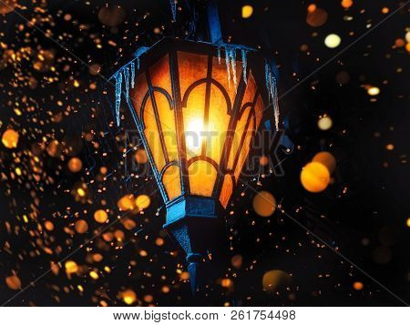 poster of A Magical Old Street Lantern Shines On The Street At Night. Many Bright Lights Around.. Vintage Old