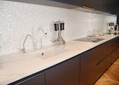 Modern Kitchen Metal Faucet, Cooker Hood And  Ceramic Kitchen Sink. Ceramic Kitchen Sink With Kitche poster