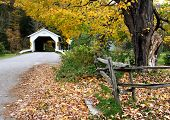 stock photo of covered bridge  - comstock covered bridge in vermont during the fall season - JPG
