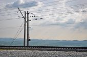 railroad track embankment and power poles