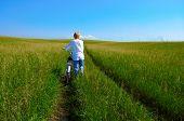 beauty redheaded girl  and bike in field