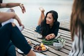 Beautiful Asian Barefooted Girl Relaxing On Wooden Pier. Relax, Vacation, Friendship Concept poster