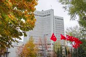 Ministry of Foreign Affairs building during autumn winds - Ankara, Turkey  poster