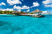 Beautiful Isolated Luxury Water Bungalows Maldives In The Blue Green Ocean Of The Maldives poster