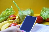 Using Calorie Counter Application On Her Smartphone. Fruits And Vegetables Of Different Colors, Gree poster