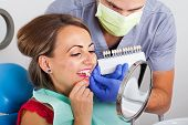 Dental Shade Determination With Shade Guide. Female Patient Wearing Pink Lipstick Close Up poster