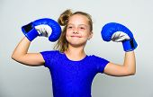 Girl Child Happy Winner With Boxing Gloves Posing On Grey Background. She Feels As Winner. Upbringin poster
