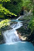 beauty waterfall with blue water