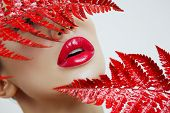 A Woman With Sensual Red Lips And A Fern poster