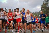 SOUTH LAKE TAHOE, CA - JUNE 14: Runners at the starting line take off after gun fires DeCelle Memori