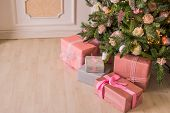 Pastel Christmas.elegant Christmas Tree With Decorations And Gifts On Elegant Hardwood Floor. Pink C poster