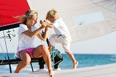mother and son on board of sea yacht