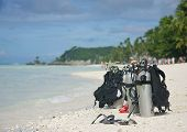 diving equipment on tropical beach