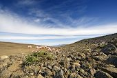 The barren, rough volcanic tundra landscape of Iceland's interior highlands with the Langjokull glac
