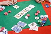 A poker game in progress with a big flop