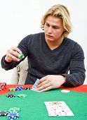 A Poker player deciding on how much to bet on his hand after the flop of a poker game