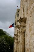 pic of texas flag  - Side Angle of the Alamo with a Texas flag in the background - JPG