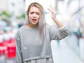 Young blonde woman over isolated background angry and mad raising fist frustrated and furious while  poster