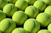 Close up of rows of tennis balls